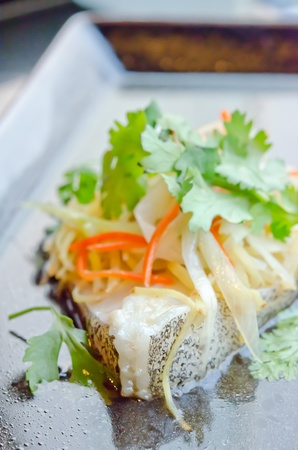 steamed white fish fillet with  vegetable  on the plate Stock Photo