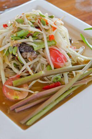spicy papaya salad  and fresh vegetable on  dish, favorite thai cuisine photo