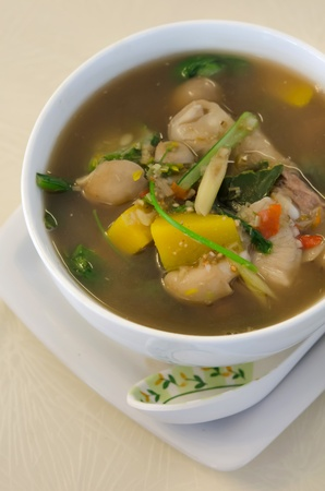 top view spicy  soup made from pork , spices and vegetables , asian style cuisine photo