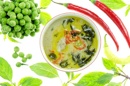 top view green chicken curry in bowl and  fresh vegetable over white background photo