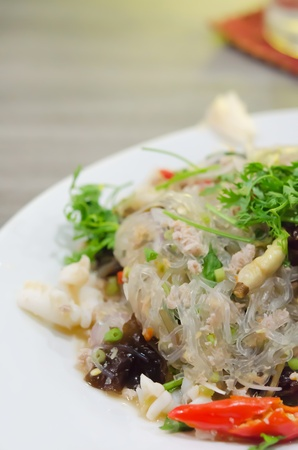 close up spicy mix seafood salad and vermicelli  , Thai spicy cuisine   photo