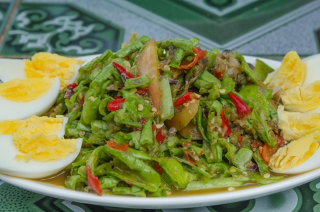 close up String bean spicy salad on plate served boiled egg , asian spicy salad photo