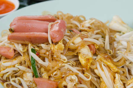 stir up: close up  stir fried  noodles with sausage ,  egg  and vegetable