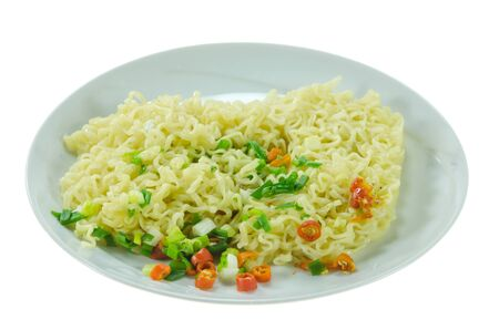 cooked instant noodle: cooked instant noodles with chili and vegetable on dish over  white background