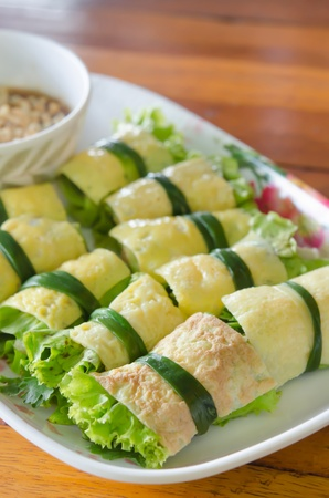 cuon: fried egg rolled with fresh vegetable , Vietnamese food ( cuon hanh )