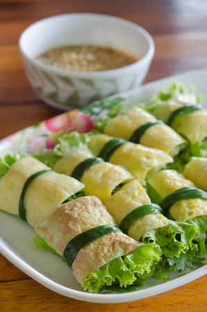 cuon: fried egg rolled with fresh vegetable , Vietnamese food ( cuon hanh ) served with chili sauce