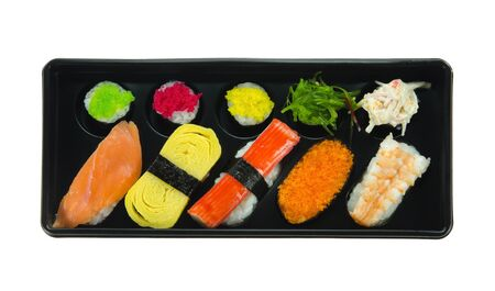 top view Japanese seafood sushi set  in black box over white background photo