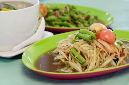spicy papaya salad with crab and vegetable , asian meal photo