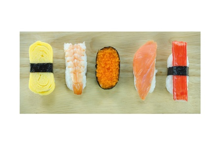 Japanese seafood sushi set , mix sushi rolls on wooden board over white  photo