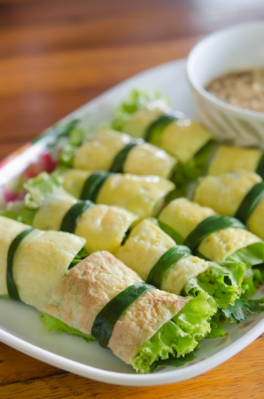cuon: close up fried egg rolled with fresh vegetable , ( cuon hanh )