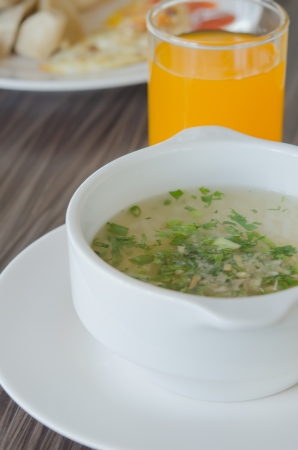 close up Rice soup with mince pork and vegetable in white bowl photo