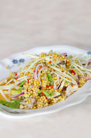 Spicy Salad made with horseshoe crab eggs   and  mix vegetable , asian cuisine photo