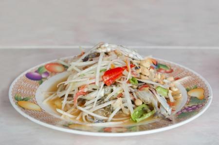 Spicy papaya salad with crab , asian favorite spicy dish photo