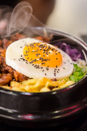 hot bibimbap in a heated stone bowl ,  korean style food photo
