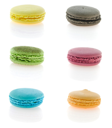 Collage from photographs of colorful  french macaroons photo