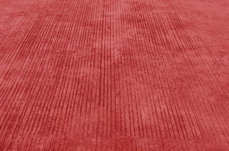 Textured cement , red concrete sidewalk stone , photo