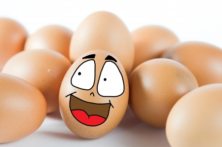 brown egg with happy face with friend photo