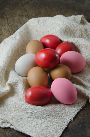 colorful of  eggs  on  sackcloth over wooden background photo
