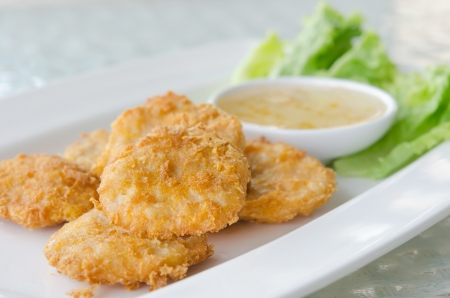 Thai Food Fried Fish Cake  Tod Mun Pla  served with sweet sauce and fresh lettuce photo
