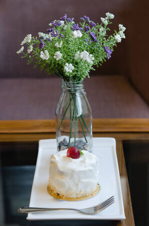 young coconut cake with fresh cream and red grape with fork photo