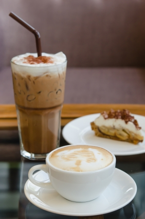 Cup of hot Coffee and ice coffee with Banoffee pie photo