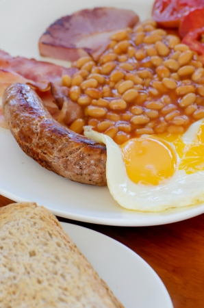Traditional English breakfast - egg,  beans , toast, sausage and bacon, photo