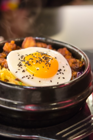 close up korean style food , bibimbap in a heated stone bowl  photo