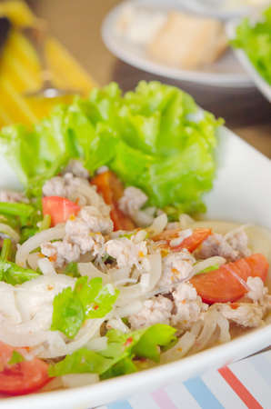 spicy  salad with  minced pork ,  vermicelli , chili and fresh vegetable , Thai style food photo