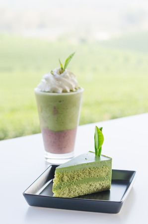 close up green tea cake and smoothie with whipped cream photo