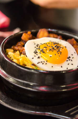 bibimbap in a heated stone bowl ,  korean style food photo