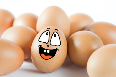 brown egg with happy face with  friend . photo
