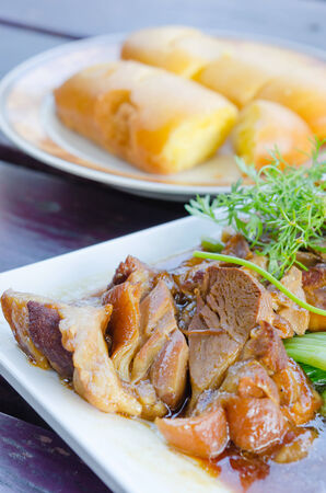 close up braised pork belly on white dish , chinese style food photo
