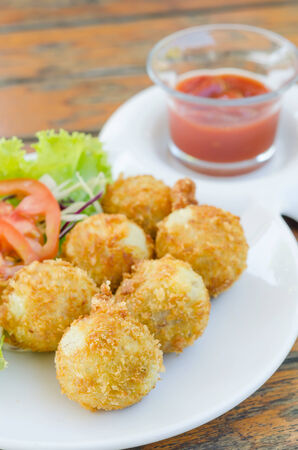 deep Fried Potato Croquettes  served with tomato sauce  and fresh vegetable photo
