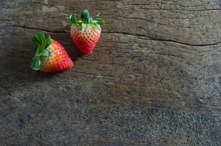 still life fresh strawberries over wooden background photo