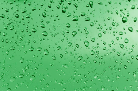 Water droplets on the glass with a colored background  Drops of water  photo