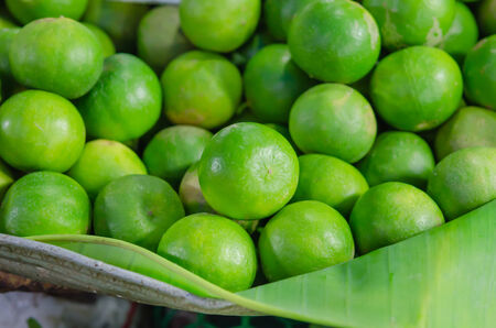 fresh green lime citrus fruit at market photo