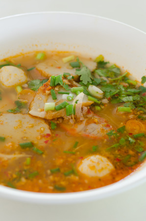 noodles with spicy soup , A famous food of Thailand photo