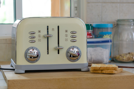 Modern design of the bread toaster in the kitchen interior photo