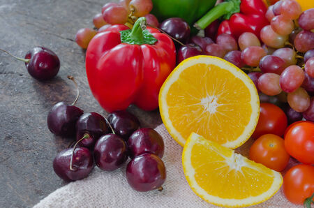mix fruits and vegetable for good  health on wooden background photo