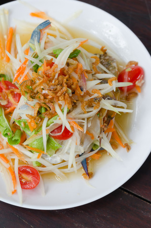 spicy papaya salad with crab on white dish , spicy food photo