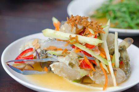 spicy mango salad with  crab , asian style food photo