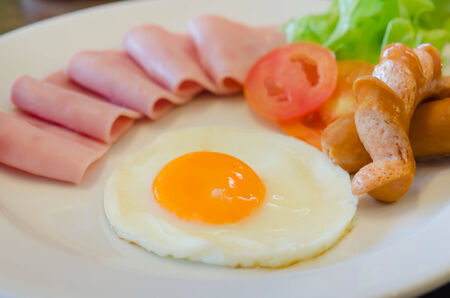 close up  fried egg, ham, sausage and fresh vegetable , fresh breakfast photo