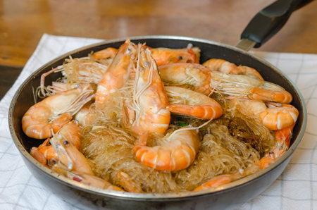 close up shrimp , baked with vermicelli , vegetable and pepper sauce photo