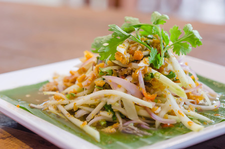 Spicy crab eggs with mango salad photo