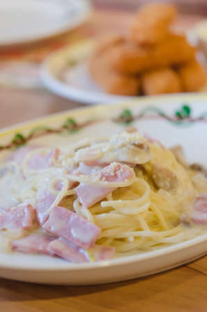 Spaghetti Carbonara with bacon and cheese on dish photo