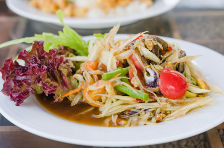 Thai spicy papaya salad serve with vegetables photo