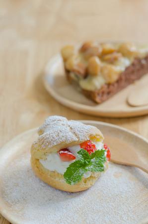 fresh strawberry Choux Cream on wooden dish photo