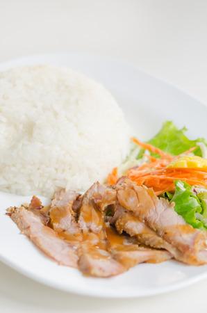 pork tenderloin: sliced pork tenderloin with fresh salad served with steamed rice
