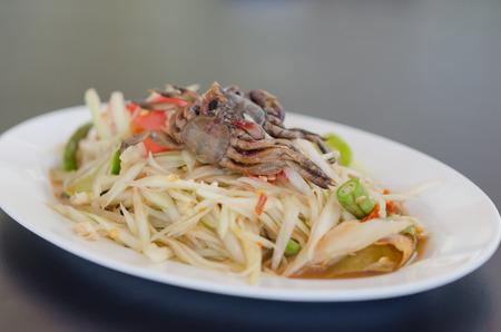 spicy papaya salad with crab on dish , asian spicy food photo