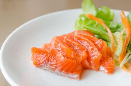close up salmon sashimi with fresh salad , japanese style cuisine photo